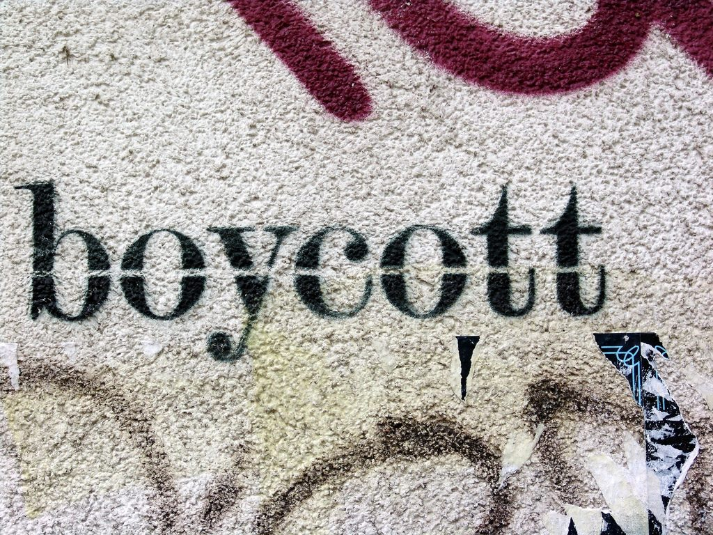 The word 'Boycott' stenciled on a concrete wall.