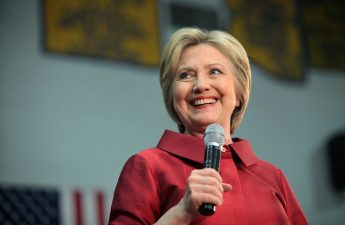 Hillary Clinton holding a microphone