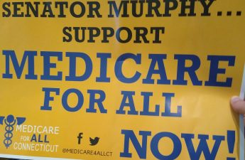 Sign that reads Senator Murphy Support Medicare for All Now